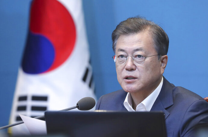 South Korean President Moon Jae-in speaks during a meeting of his senior secretaries at the presidential Blue House in Seoul, South Korea, Monday, April 27, 2020. Moon repeated an offer to conduct some inter-Korean cooperation projects such as a joint anti-coronavirus quarantine campaign. Moon also said he will strive for mutual prosperity