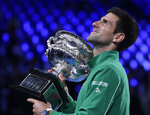 FILE - In this Feb. 3, 2020, file photo, Serbia's Novak Djokovic holds the Norman Brookes Challenge Cup after defeating Austria's Dominic Thiem in the final of the Australian Open tennis championship in Melbourne, Australia. (AP Photo/Andy Brownbill, File)