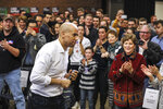 FILE - In this Oct. 28, 2018, file photo, Sen. Cory Booker, D-N.J., exits the stage after speaking at a get out the vote event hosted by the NH Young Democrats at the University of New Hampshire in Durham, N.H. Even before they announce their White House intentions, New Hampshire's ambitious neighbors are in the midst of a shadow campaign to shape the nation's first presidential primary election of the 2020 season.(AP Photo/ Cheryl Senter, File)
