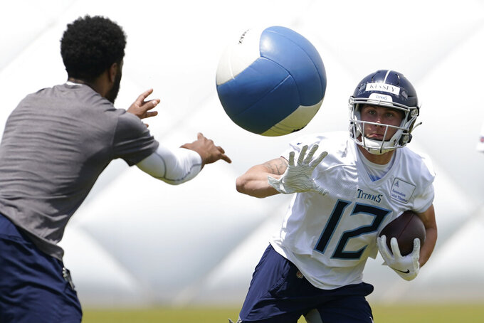 Tennessee Titans wide receiver Mason Kinsey (12) knocks a ball out of the way as he runs a drill during NFL football rookie minicamp Saturday, May 15, 2021, in Nashville, Tenn. (AP Photo/Mark Humphrey, Pool)