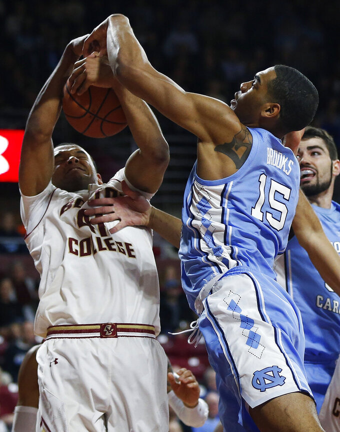 Boston College's Steffon Mitchell (41) and North Carolina's Garrison Brooks (15) battle for a rebound during the second half of an NCAA college basketball game in Boston, Tuesday, March 5, 2019. (AP Photo/Michael Dwyer)