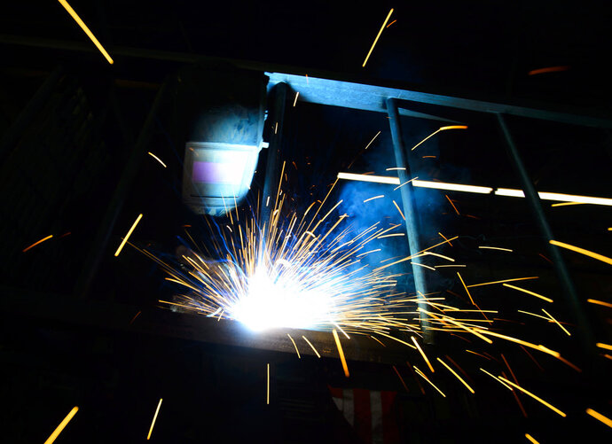 A welder fabricates a steel structure at an iron works facility in Ottawa, Ontario, Monday, March 5, 2018. President Donald Trump insisted Monday that he's