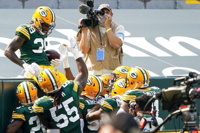 Green Bay Packers' Chandon Sullivan celebrates his interception returned for a touchdown during the second half of an NFL football game against the Detroit Lions Sunday, Sept. 20, 2020, in Green Bay, Wis. (AP Photo/Morry Gash)
