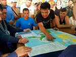 In this Oct. 27, 2019, photo provided by the Sihanoukville Province Authority Police, officers show a map of Koh Rong where British national Amelia Bambridge went missing, in  Preah Sihanouk province, Cambodia. She has not been seen since last Wednesday night, Oct. 23, 2019, when she went to a beach party on Koh Rong island in southwestern Cambodia. (Sihanoukville province Authority Police via AP)