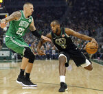 Milwaukee Bucks' Khris Middleton drives to the basket against Boston Celtics' Daniel Theis during the first half of an NBA basketball game Thursday, Feb. 21, 2019, in Milwaukee. (AP Photo/Aaron Gash)