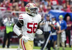 """FILE - In this Oct. 28, 2018, file photo, San Francisco 49ers' Reuben Foster (56) jogs on the field during the first half of an NFL football game against the Arizona Cardinals in Glendale, Ariz. Foster's ex-girlfriend tells ABC's """"Good Morning America"""" that he slapped her and pushed her during an incident in Tampa, Fla., that led to his arrest for domestic violence. Elissa Ennis says in an interview televised Thursday, Dec. 6, 3028, that Foster abused her three times, most recently last month in Tampa. (AP Photo/Darryl Webb, File)"""