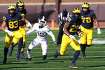 Michigan running back Hassan Haskins (25) rushes during the second half of an NCAA college football game against Michigan State, Saturday, Oct. 31, 2020, in Ann Arbor, Mich. (AP Photo/Carlos Osorio)