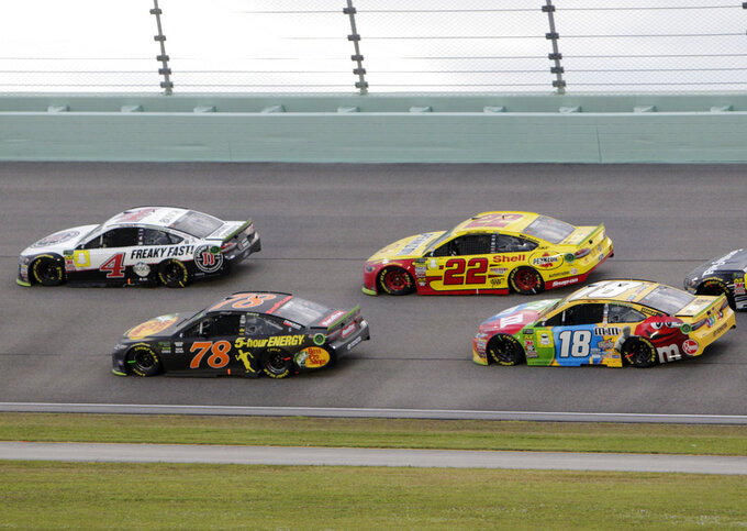 Kevin Harvick (4), Martin Truex Jr. (78), Joey Logano, Kyle Busch (18) drive on the track during the NASCAR Cup Series Championship auto race at the Homestead-Miami Speedway, Sunday, Nov. 18, 2018, in Homestead, Fla. (AP Photo/Darryl Graham)