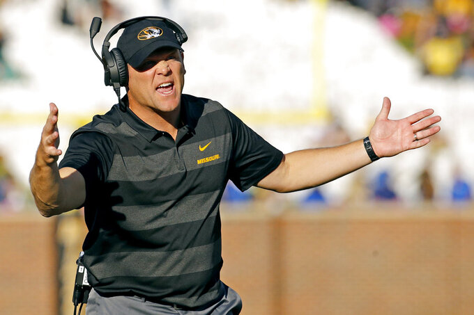 FILE - In this Saturday, Oct. 27, 2018, file photo, Missouri head coach Barry Odom talks to officials during the first half of an NCAA college football game against Kentucky in Columbia, Mo. The Tigers lost a heartbreaker at home last week to Kentucky, rallying from an 11-point deficit in the fourth quarter before losing on a touchdown pass on the final play. (AP Photo/Charlie Riedel, File)