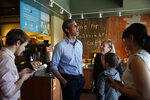 Democratic presidential candidate and former Texas congressman Beto O'Rourke laughs while meeting people at a restaurant Sunday, March 24, 2019, in Las Vegas. (AP Photo/John Locher)