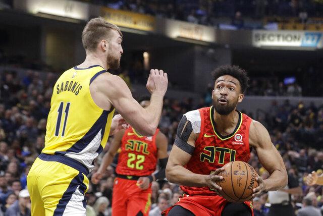 Atlanta Hawks' Jabari Parker (5) goes to the basket against Indiana Pacers' Domantas Sabonis (11) during the first half of an NBA basketball game, Friday, Nov. 29, 2019, in Indianapolis. (AP Photo/Darron Cummings)