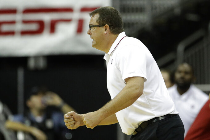 Stanford head coach Jerod Haase talks to his players during the second half of an NCAA college basketball game against Butler Tuesday, Nov. 26, 2019, in Kansas City, Mo. Butler won 68-67. (AP Photo/Charlie Riedel)