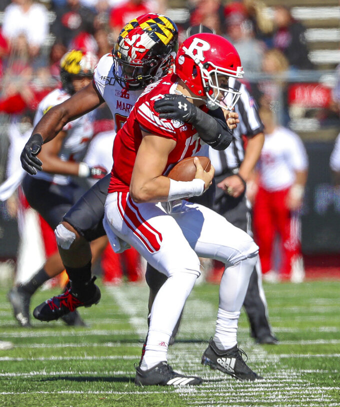 Maryland defensive lineman Lawtez Rogers (95) sacks Rutgers quarterback Johnny Langan (17) during the first half of an NCAA college football game, Saturday Oct. 5, 2019, in Piscataway, N.J. (Andrew Mills/NJ Advance Media via AP)