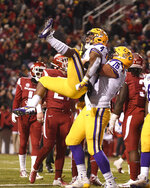 LSU running back Nick Brossette celebrates with teammate Austin Deculus after scoring a touchdown in the first half of an NCAA college football game against Arkansas, Saturday, Nov. 10, 2018, in Fayetteville, Ark. (AP Photo/Michael Woods)