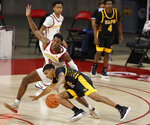 Iowa State guard Jalen Coleman-Lands, left, defends as Arkansas-Pine Bluff guard Nicholas Jones, center, loses control of the ball during the second half of an NCAA college basketball game, Sunday, Nov. 29, 2020, in Ames, Iowa. (AP Photo/Matthew Putney)