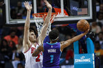 Charlotte Hornets guard Malik Monk, right, shoots against Chicago Bulls forward Luke Kornet during the first half of an NBA basketball game in Charlotte, N.C., Wednesday, Oct. 23, 2019. (AP Photo/Nell Redmond)