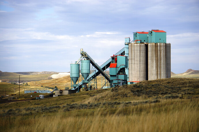 FILE  - This Friday, Sept. 6, 2019, file photo, shows the Eagle Butte mine just north of Gillette, Wyo. Another coal company has entered a potential bankruptcy deal that could allow the Eagle Butte and Belle Ayr, two idle Wyoming coal mines, to reopen. Bristol, Tennessee-based Contura Energy announced Wednesday, Sept. 18, 2019, it has reached a tentative deal to pay Jasper, Alabama-based FM Coal $90 million to take the Eagle Butte and Belle Ayr mines. (AP Photo/Mead Gruver, File)