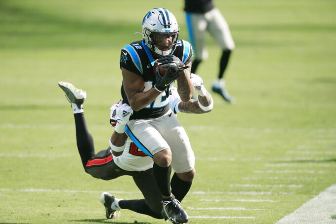 Carolina Panthers wide receiver D.J. Moore (12) makes the catch against the Tampa Bay Buccaneers during the first half of an NFL football game, Sunday, Nov. 15, 2020, in Charlotte , N.C. (AP Photo/Brian Blanco)