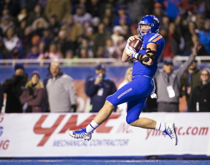 Boise State tight end John Bates secures a long pass into the red zone during the team's NCAA college football game against Utah State on Saturday, Nov. 24, 2018, in Boise, Idaho. (Darin Oswald/Idaho Statesman via AP)