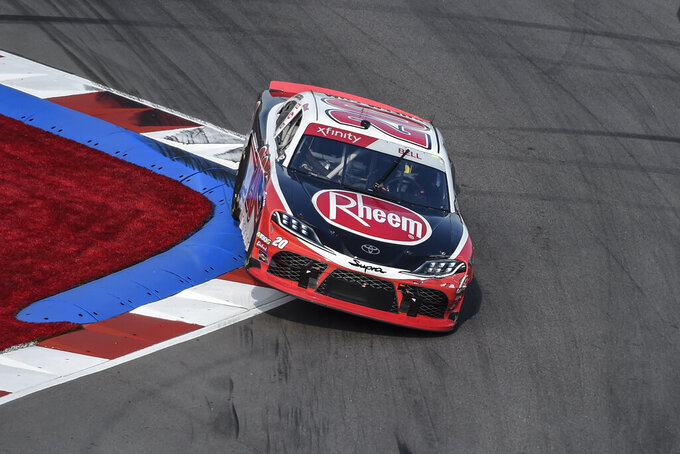 Christopher Bell (20) drives through Turn 17 during a NASCAR Xfinity Series auto race at Charlotte Motor Speedway, Saturday, Sept. 28, 2019, in Concord, N.C. (AP Photo/Mike McCarn)