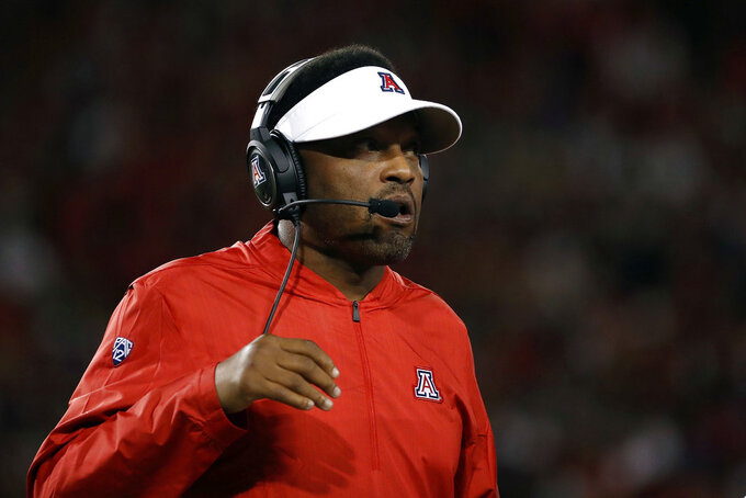 Arizona coach Kevin Sumlin watches during the first half of the team's NCAA college football game against California on Saturday, Oct. 6, 2018, in Tucson, Ariz. (AP Photo/Chris Coduto)