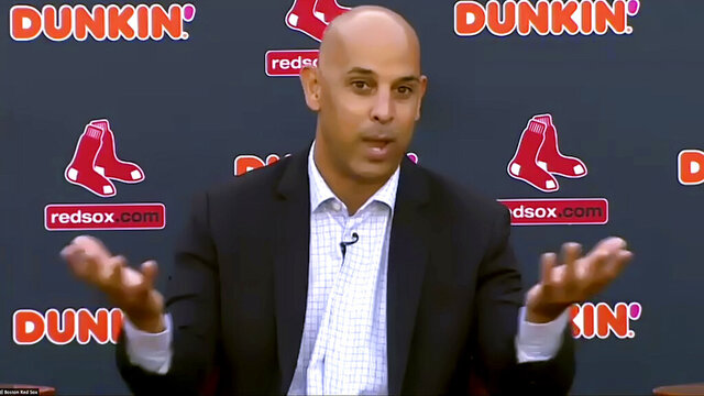 In this still image from an online video news conference provided by the Boston Red Sox, manager Alex Cora speaks Tuesday, Nov. 10, 2020, at Fenway Park in Boston. Cora, who led the Red Sox to the 2018 World Series title, was rehired as manager less than a year after the team let him go because of his role in the Houston Astros' cheating scandal. (Boston Red Sox via AP)