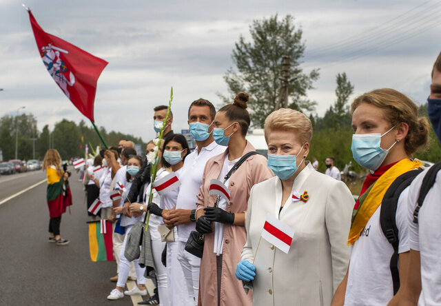 Former Lithuanian President Dalia Grybauskaite, second from right, and other supporters of Belarus opposition participate in a