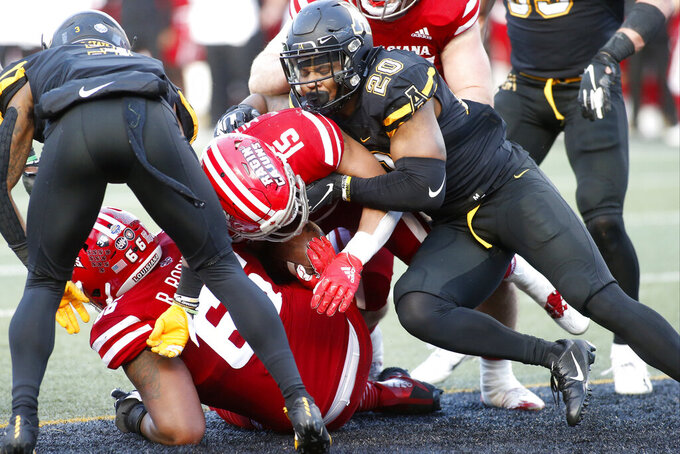 Louisiana-Lafayette running back Elijah Mitchell (15) is hit by Appalachian State linebacker Noel Cook (20) as he scores a touchdown during the second half of an NCAA college football game in the Sun Belt Football Championship on Saturday, Dec. 7, 2019, in Boone, N.C. (AP Photo/Brian Blanco)