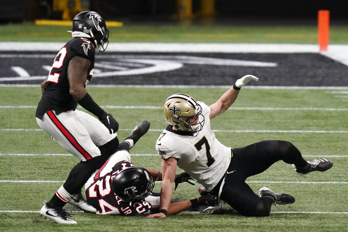 New Orleans Saints quarterback Taysom Hill (7) fumbles the ball against the Atlanta Falcons during the second half of an NFL football game, Sunday, Dec. 6, 2020, in Atlanta. (AP Photo/Brynn Anderson)