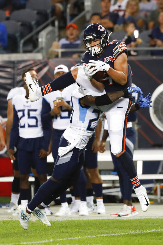 Chicago Bears wide receiver Thomas Ives (14) makes a catch against Tennessee Titans cornerback Tye Smith (23) during the first half of an NFL preseason football game Thursday, Aug. 29, 2019, in Chicago. (AP Photo/Charles Rex Arbogast)