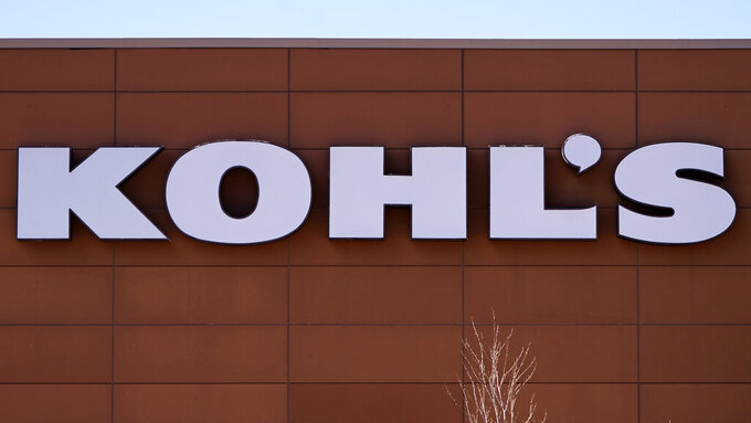 A sign outside the Kohl's store, Friday, Feb. 26, 2021, in Salem, N.H.  Kohl's.  Kohl's Corp. raised its financial outlook  Thursday, May 20, after the department store chain's fiscal first quarter results showed that the department store chain is making a solid rebound from the devastating impact of the pandemic.  (AP Photo/Charles Krupa)