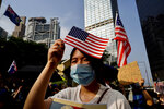 Protesters wave U.S. flags and shout slogans as they march from Chater Garden to the U.S. c\Consulate in Hong Kong, Sunday, Sept. 8, 2019. Demonstrators in Hong Kong plan to march to the U.S. Consulate on Sunday to drum up international support for their protest movement, a day after attempts to disrupt transportation to the airport were thwarted by police. (AP Photo/Vincent Yu)