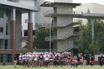 Washington State players huddle at the end of the first day of NCAA college football practice, Friday, Aug. 6, 2021, in Pullman, Wash. (AP Photo/Ted S. Warren)