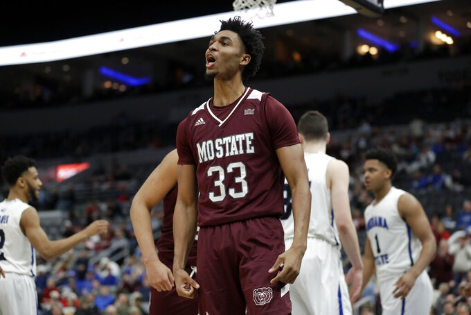 Missouri State's Josh Hall celebrates during the second half of an NCAA college basketball game against Indiana State in the quarterfinal round of the Missouri Valley Conference men's tournament Friday, March 6, 2020, in St. Louis. (AP Photo/Jeff Roberson)