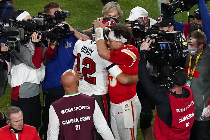 Tampa Bay Buccaneers' Tom Brady (12) and Kansas City Chiefs' Patrick Mahomes (15) greet following the NFL Super Bowl 55 football game Sunday, Feb. 7, 2021, in Tampa, Fla. The Buccaneers defeated the Chiefs 31-9 to win the Super Bowl. (AP Photo/Chris Carlson)