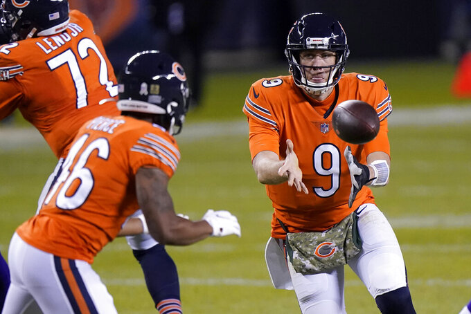 Chicago Bears quarterback Nick Foles (9) laterals to running back Artavis Pierce (46) during the second half of an NFL football game against the Minnesota Vikings Monday, Nov. 16, 2020, in Chicago. (AP Photo/Nam Y. Huh)