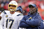 FILE - In this Sunday, Dec. 29, 2019, file photo, Los Angeles Chargers coach Anthony Lynn stands next to quarterback Philip Rivers during the second half of the team's NFL football game against the Kansas City Chiefs in Kansas City, Mo. Los Angeles — which was 5-11 last season after making the playoffs in 2018 — will have a new quarterback after it announced in February that it would not re-sign Rivers. Lynn and Chargers quarterback Tyrod Taylor were together in Buffalo for two seasons. (AP Photo/Charlie Riedel, File)