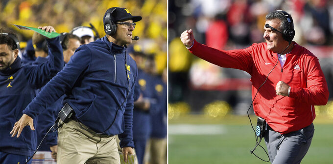 FILE - At left, in an Oct. 13, 2018, file photo, Michigan head coach Jim Harbaugh signals to his offense from the sidelines in the second quarter of an NCAA college football game against Wisconsin in Ann Arbor, Mich. At right, in a Nov. 17, 2018, file photo, Ohio State head coach Urban Meyer gestures during the first half of an NCAA football game against Maryland, in College Park, Md. Michigan plays at Ohio State on Saturday.  (AP Photo/File)