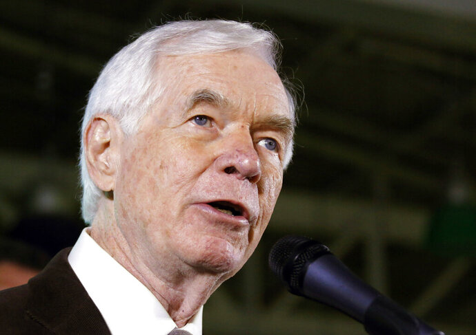 FILE - In this Nov. 4, 2014, file photo, U.S. Sen. Thad Cochran, R-Miss., speaks to supporters in Jackson, Miss., following his reelection to the U.S. Senate. The Navy will name a ship after the late senator who was a Navy veteran. Cochran's successor, Republican Sen. Cindy Hyde-Smith, said Wednesday, Nov. 13, 2019, that Navy Secretary Richard V. Spencer has decided that a future Arleigh Burke-class guided-missile destroyer will be called the USS Thad Cochran. (AP Photo/Rogelio V. Solis, File)