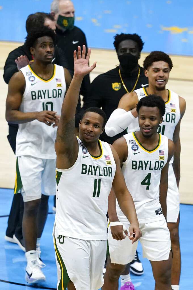 Baylor players walk off the court at the end of a men's Final Four NCAA college basketball tournament semifinal game against Houston, Saturday, April 3, 2021, at Lucas Oil Stadium in Indianapolis. Baylor won 78-59. (AP Photo/Darron Cummings)