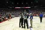 Officials confer after an NBA summer league basketball game between the New York Knicks and the New Orleans Pelicans was stopped due to an earthquake Friday, July 5, 2019, in Las Vegas. (AP Photo/Steve Marcus)