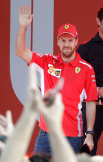 Ferrari driver Sebastian Vettel of Germany waves during the launch for the Australian Grand Prix in Melbourne, Australia, Wednesday, March 13, 2019. (AP Photo/Rick Rycroft)
