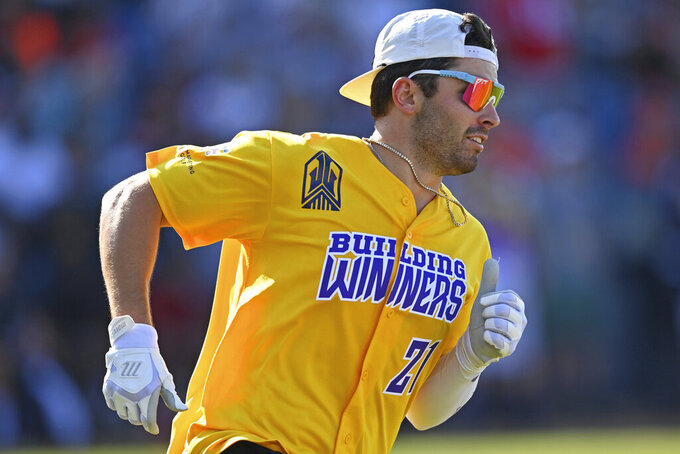 Cleveland Browns quarterback Baker Mayfield runs after a hit during the Jarvis Landry Celebrity Softball game Saturday, June 12, 2021, in Eastlake, Ohio. (AP Photo/David Dermer)