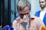 Prominent Russian investigative journalist Ivan Golunov, cries as he leaves a Investigative Committee building in Moscow, Russia, Tuesday, June 11, 2019. In a surprising turnaround, Russia's police chief on Tuesday dropped all charges against a prominent investigative reporter whose detention sparked public outrage and promised to go after the police officers who tried to frame the journalist as a drug-dealer. (AP Photo/Pavel Golovkin)