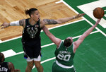 Milwaukee Bucks forward D.J. Wilson (5) defends against a shot by Boston Celtics forward Gordon Hayward (20) in the first quarter of an NBA basketball game, Friday, Dec. 21, 2018, in Boston. (AP Photo/Elise Amendola)