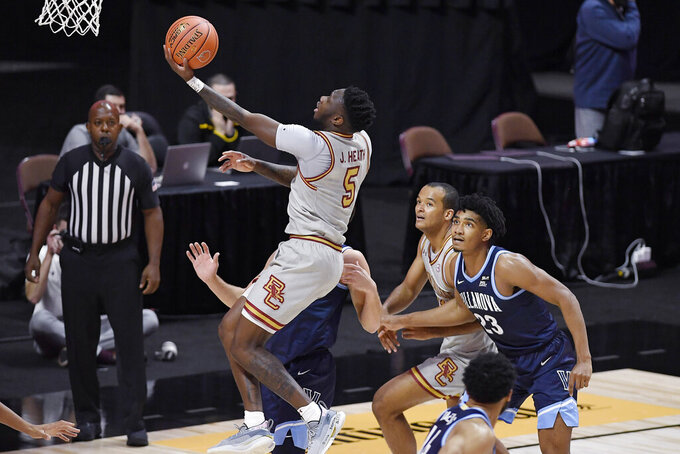 Boston College's Jay Heath pulls up for a basket in the first half of an NCAA college basketball game against Villanova, Wednesday, Nov. 25, 2020, in Uncasville, Conn. (AP Photo/Jessica Hill)