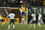 Colorado Rapids' Jack McBean (32) jumps for a head ball during an MLS soccer match against the Portland Timbers on Saturday, Sept. 8, 2018, in Portland, Ore. (Kent Frasure/The Oregonian via AP)