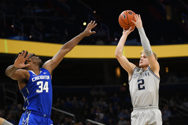Georgetown guard Mac McClung (2) shoots as he is defended by Creighton guard Denzel Mahoney (34) during the second half of an NCAA college basketball game, Wednesday, Jan. 15, 2020, in Washington. Georgetown won 83-80. (AP Photo/Nick Wass)