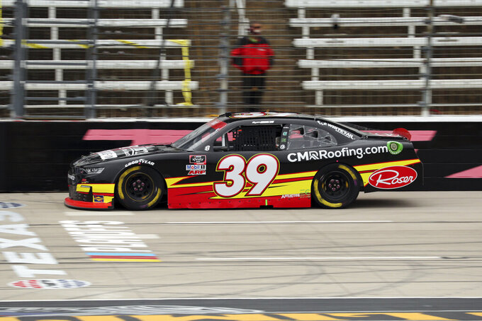 NASCAR Xfinity Series driver Ryan Sieg (39) races on the front stretch during a NASCAR Xfinity Series auto race at Texas Motor Speedway in Fort Worth, Texas, Saturday Oct. 24, 2020. (AP Photo/Richard W. Rodriguez)