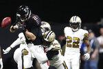 New Orleans Saints defensive end Marcus Davenport (92) hits Atlanta Falcons quarterback Matt Ryan (2) causing a fumble during the second half of an NFL football game, Thursday, Nov. 28, 2019, in Atlanta. (AP Photo/John Bazemore)
